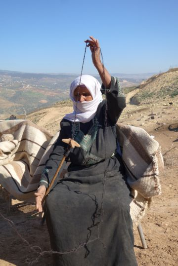 Bedouin lady spinning wool